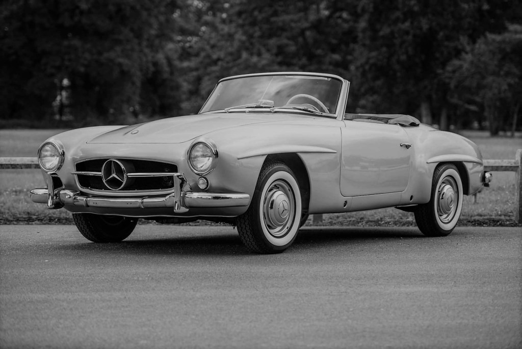 A Mercedes 190 SL with roof down
