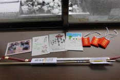 The New Year cards I received and the charms and bow and arrow I bought at the shrine.