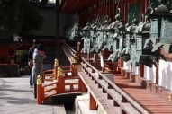 Saying prayers in front of one of the main shrines,