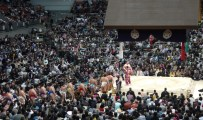The highest ranked wrestlers parading into the ring.