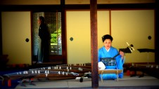 A lady playing shamisen in Ritsuin Park