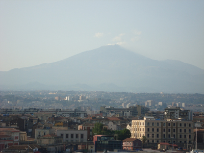 Mt Etna looking quite peaceful. Note the wisps of steam cominng from the top of the mountain.