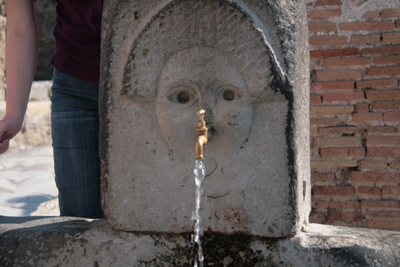 Drinking fountain on a public street.