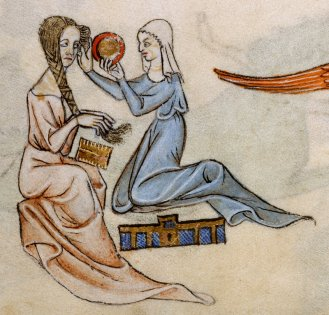 Maid and lady both in simple loose cotes with tight sleeves. The lady is having her hair braided and pined by her maid, who is wearing a veil. c. 1325-1335.