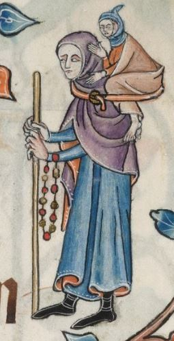 Pilgrim wearing a hooded purple cloak over a long blue cote. I am guessing she is wearing a child on her back? c.1325-1335