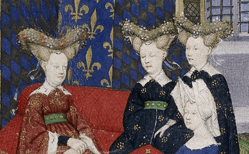 "Christine de Pisan presents her book to Queen Isabeau of France. She and her ladies wear jewelled heart-shaped stuffed or hollow ""bourrelets"" on top of hair dressed in horns. Christine wears a divided hennin covered in white cloth. c 1410 - 1414"