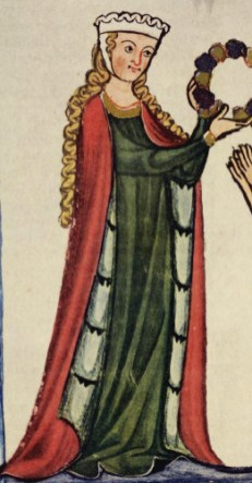 Woman presenting a chaplet wears a linen barbet and fillet headdress. She also wears a fur-lined mantle or cloak, c. 1305–1340.