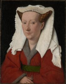 Margarete van Eyck wears a horned headdress with a ruffled veil called a kruseler. Her red gown is lined in grey fur, 1439.