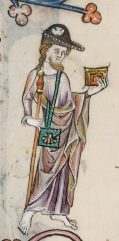 Pilgrim wearing a long tunic, cloak and a pointed hat. On his bag is sown a sea shell that is normally worn by particular pilgrims. Pilgrim, 1325-1340
