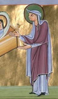 Light blue cote under a purple long tunic what ends at the albows. She also wears a mantle over her head. c. 1007-1012