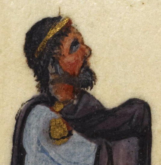 King with a full beard, short hair that is long in the neck is wearing a ring of gold around his head.