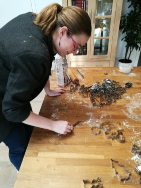 My sister making jewish christmas cookies using cookie cutters