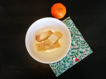 Bowl of coconut shortbread and a clementine
