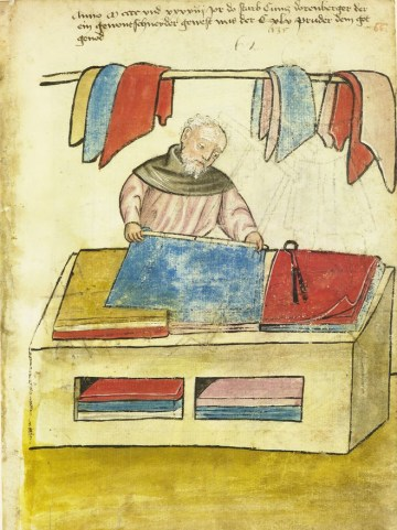 Man cutting coloured fabric