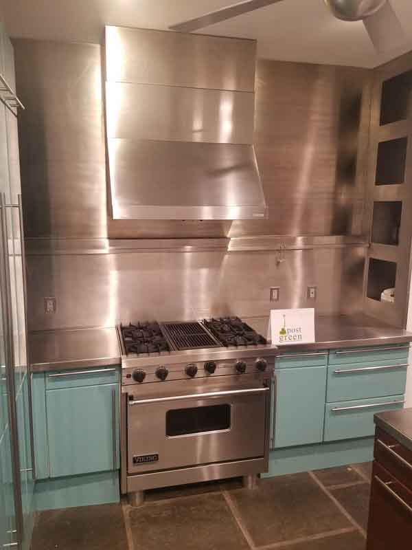Stainless steel kitchen with tile floors