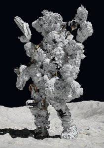 A figure in a space suit made of bunched up fabric walks on the moon.