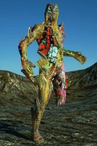 A golden figure missing a leg stands in a golden mountain range.