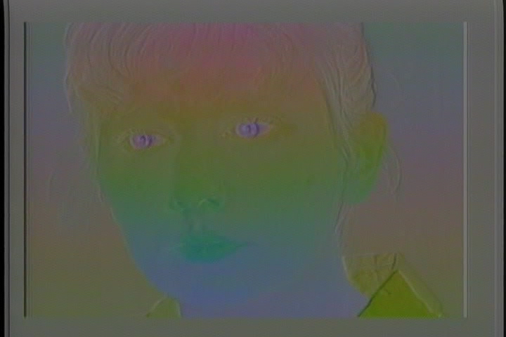 An image of a grey-toned young woman looking around while a rainbow filter washes over her.
