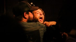 Logan Abbey, left, tries to contain Zak Haab's exuberance during a set by Seattle's Blood of Kings.