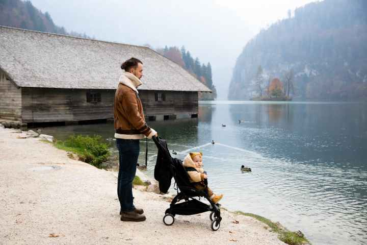 photo of man holding stroller