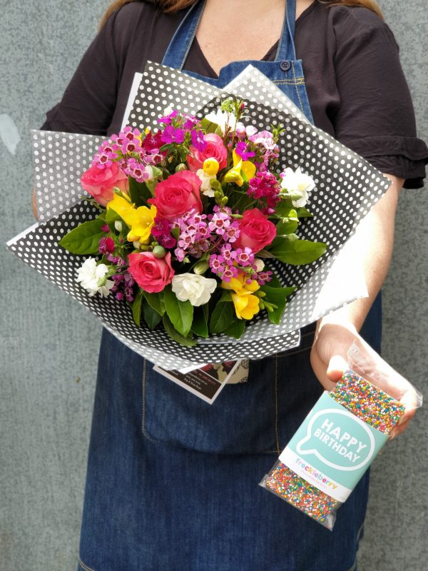 bundle of flowers and bar of chocolate