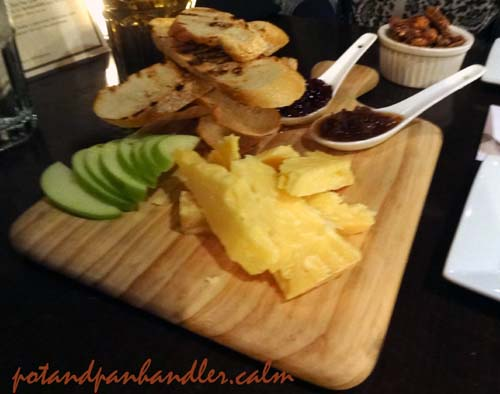 Aged Cheddar Cheese with apple, fig jam, cranberry honey & toasted baguettes at Philadelphia, Pennsylvania's Tavern on Camac