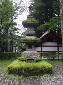 Moss-covered, part of Shinto shrine