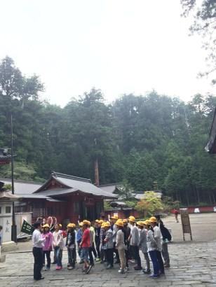 Japanese school field trip, listening intently