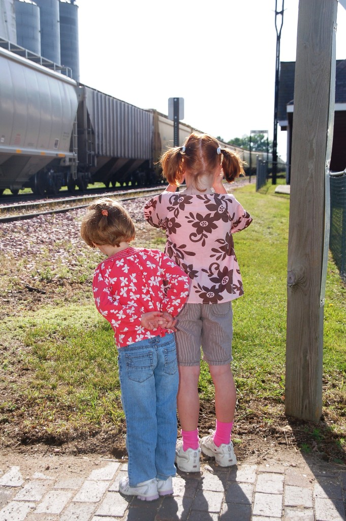 At the depot we found a letterbox AND a scavenger hunt postcard. We were lucky enough to get there when a train was coming through. The girls were mesmerized.