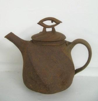 altered teapot w/ unglazed exterior