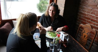 Courtney Hawkins, left, and Jill Savory, right, eat at the vegetarian restaurant Firefly Cafe on their opening day.