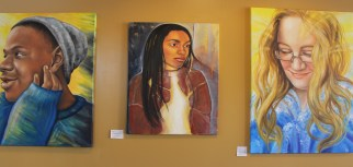 Paintings of local artists are displayed on the wall of the vegetarian restaurant Firefly Cafe in Boyertown. The cafe has a rotating gallery of paintings to allow local artists to showcase their work.