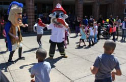 Mascots dance alongside children to music during the combined PEAK Pottstown Celebrates Young Children and YMCA Healthy Kids Day event Saturday afternoon.