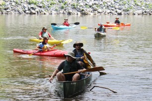 Paddlers paddle along at Riverfront Park in Pottstown as part of the 18th annual Schuylkill River Sojourn.
