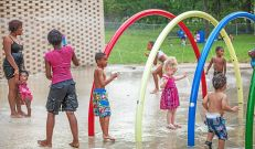 Children and adults enjoy a hot summer day at the Pottstown Spray Park. photo by Mike Keaveney