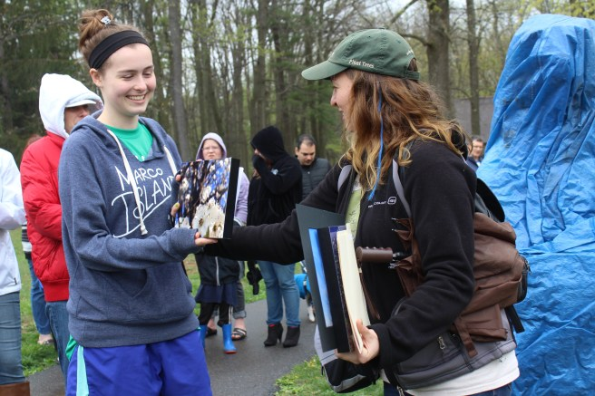 Building a Better Boyertown main street manager Adrianne Blank, right, presents an award to Hannah Ziegler, 16, for winning the 2017 Tree Photo Contest. Winners were awarded during EarthFest at Boyertown Community Park on Saturday, April 22, 2017. Michilea Patterson — Digital First Media