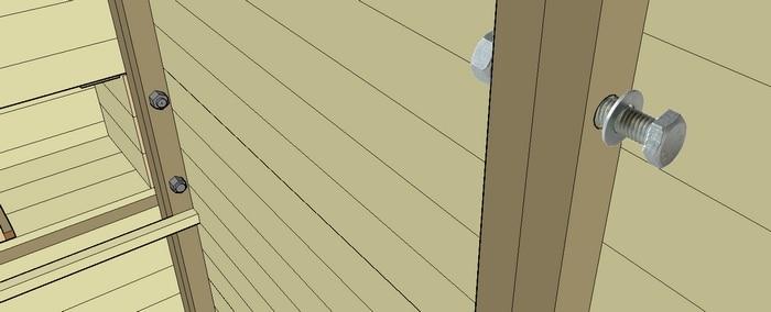 assemblage par boulons des élements en planches de palettes