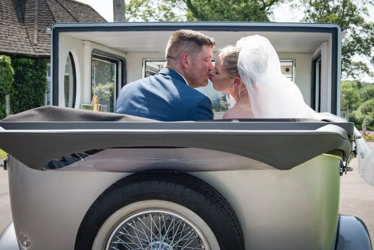 Bride and Groom on their Wedding Day at Eastwood Park in South Gloucestershire wedding car