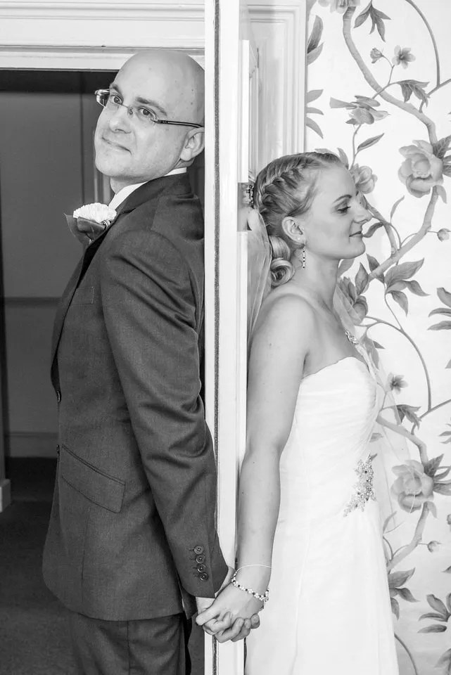Wedding behind the door at Leigh Park hotel in Wiltshire