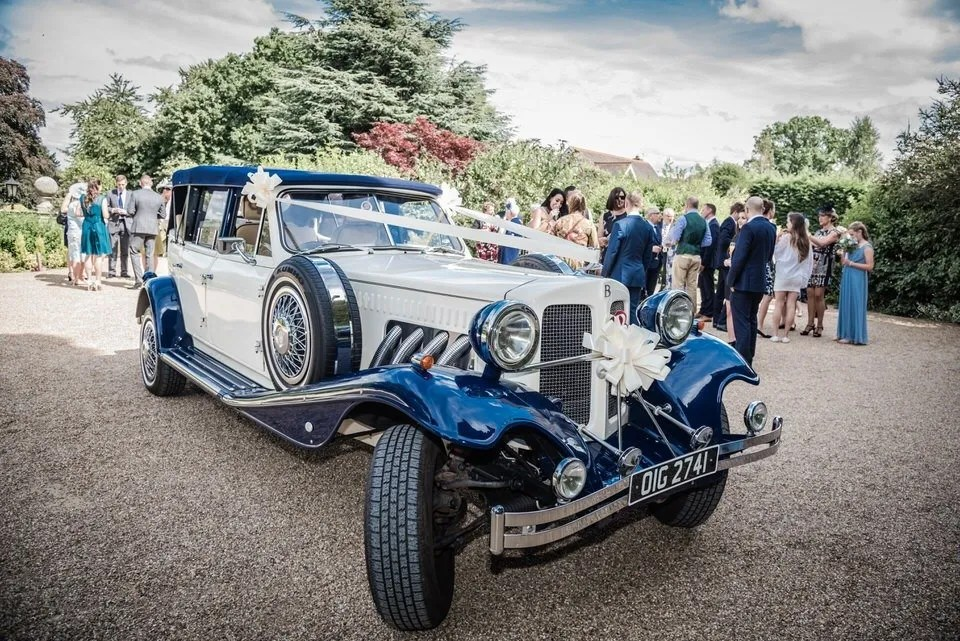 Wedding car at Manor by the Lake in Gloucestershire