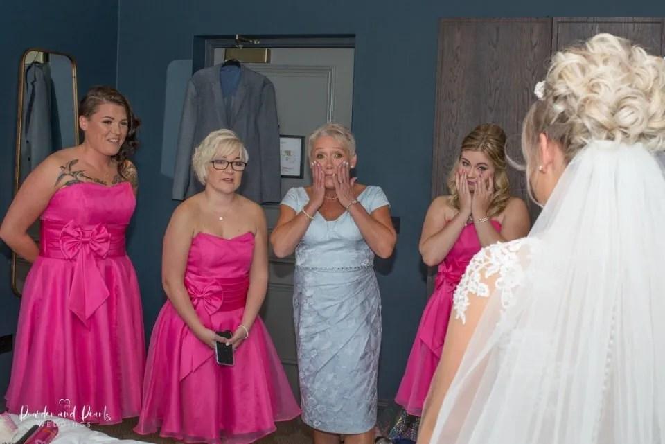 Bridesmaids shocked by beautiful wedding dress