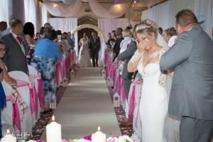 Brides cry as they walk down the wedding isle