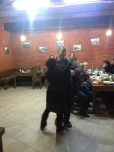 Junior celebrates a successful adventure by dancing the night away in Tbilisi