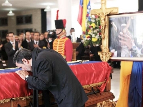 Mahmoud Ahmadinejad kisses Chavez's casket at his funeral in March 2013