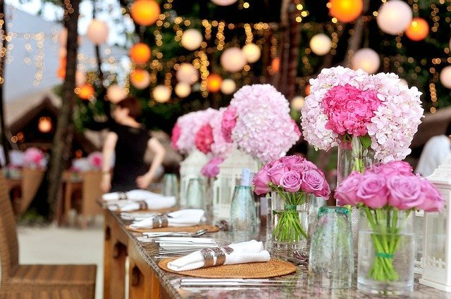 banquet table with pink flowers in vases