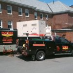 black pickup truck and trailer in front of commercial generators