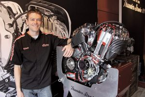Eric Fox, chief designer of Indian's Thunder Stroke 111 engine, with the final product at the Bike Week launch. (Photo by Robert Filla)