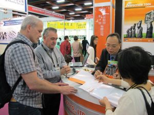 Tucker Rocky execs Charlie Hadayia, Jr. (left) and Brian Berney listen to a vendor presentation in Taipei.