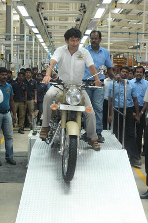 Eicher Motors Ltd CEO Siddhartha Lal rolls out the first motorcycle, the Royal Enfield Desert Storm, from the company's new plant in Oragadam, India.