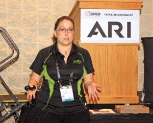 Lea Scudamore, SEO supervisor at ARI Network Services, speaks during one of her two sessions at the Powersports Business Institute @ AIMExpo in October in Orlando.